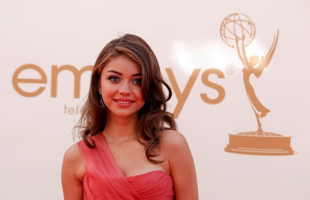 "Actress Sarah Hyland from ""Modern Family"" poses as she arrives at the 63rd Primetime Emmy Awards in Los Angeles"