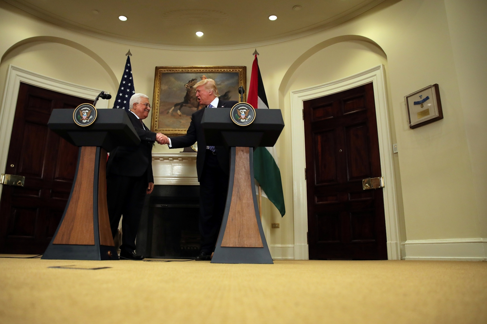 Donald Trump and Mahmoud Abbas shake hands