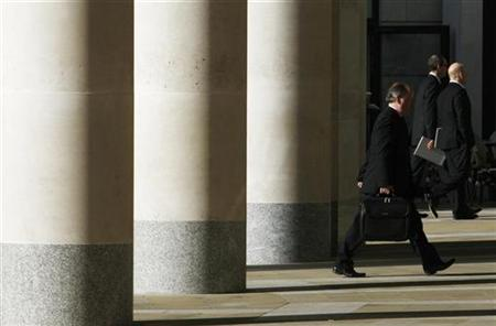 City workers walk outside the London Stock Exchange in Paternoster Square