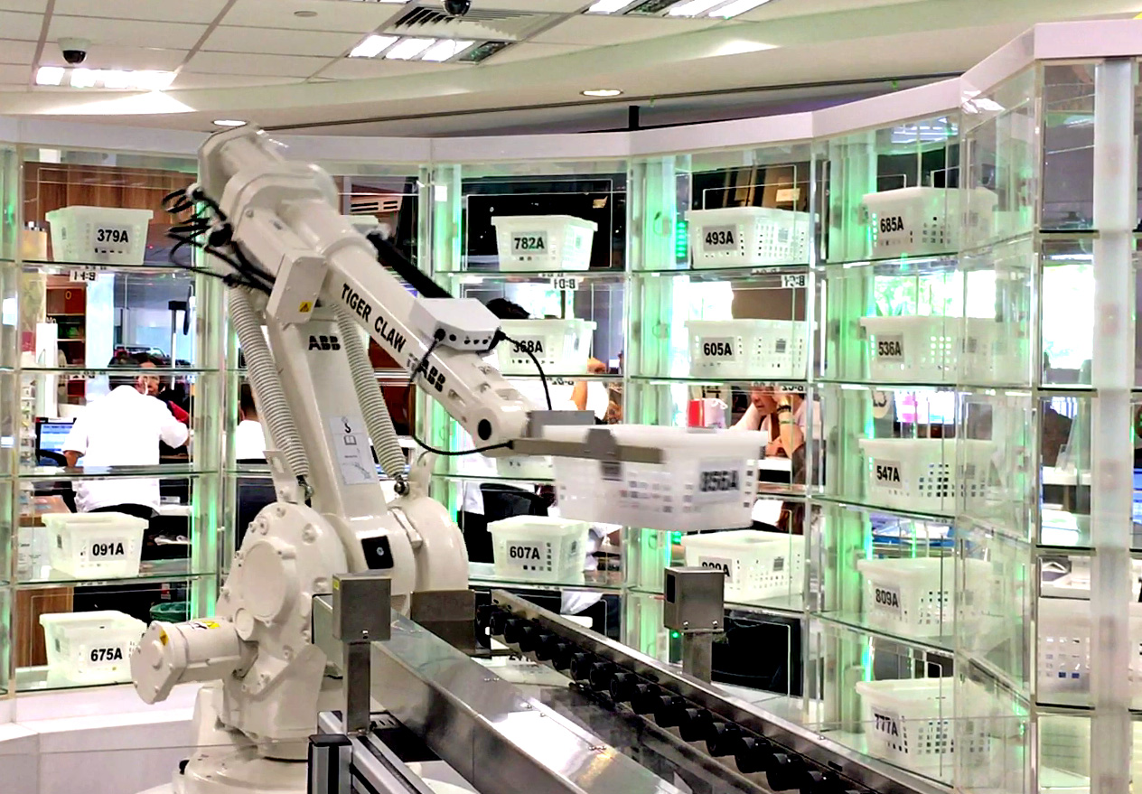 Robot arm automating medication dispensing in Singapore