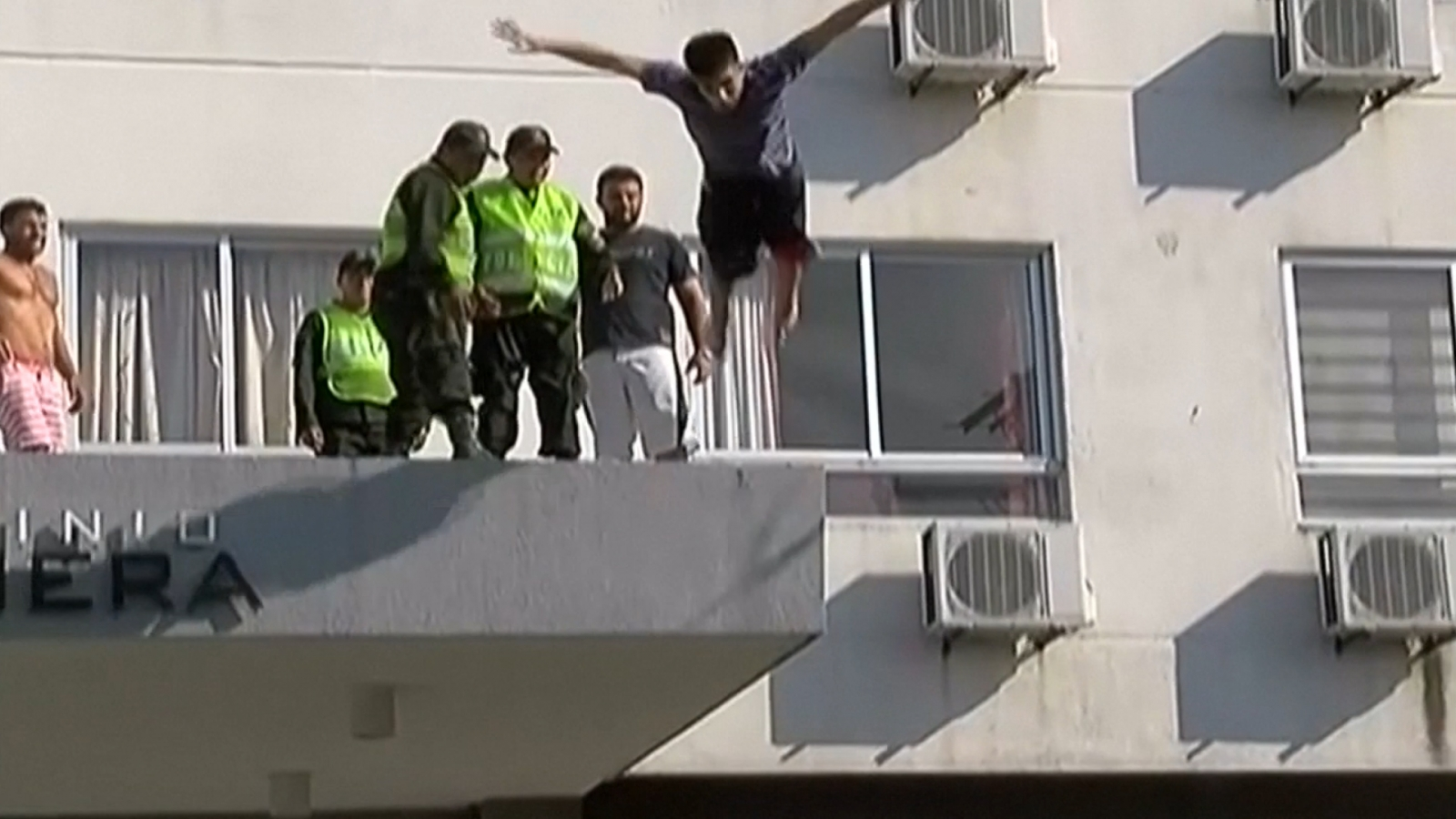 Teenager miraculously survives after headfirst swan dive off building