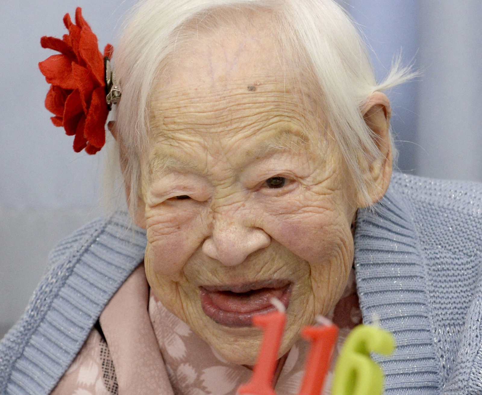 Here's a reason not to smile: it makes you look older