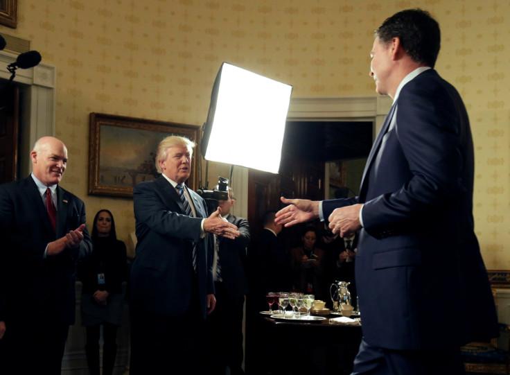 Donald Trump greets James Comey