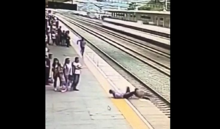 Railway staff saves woman