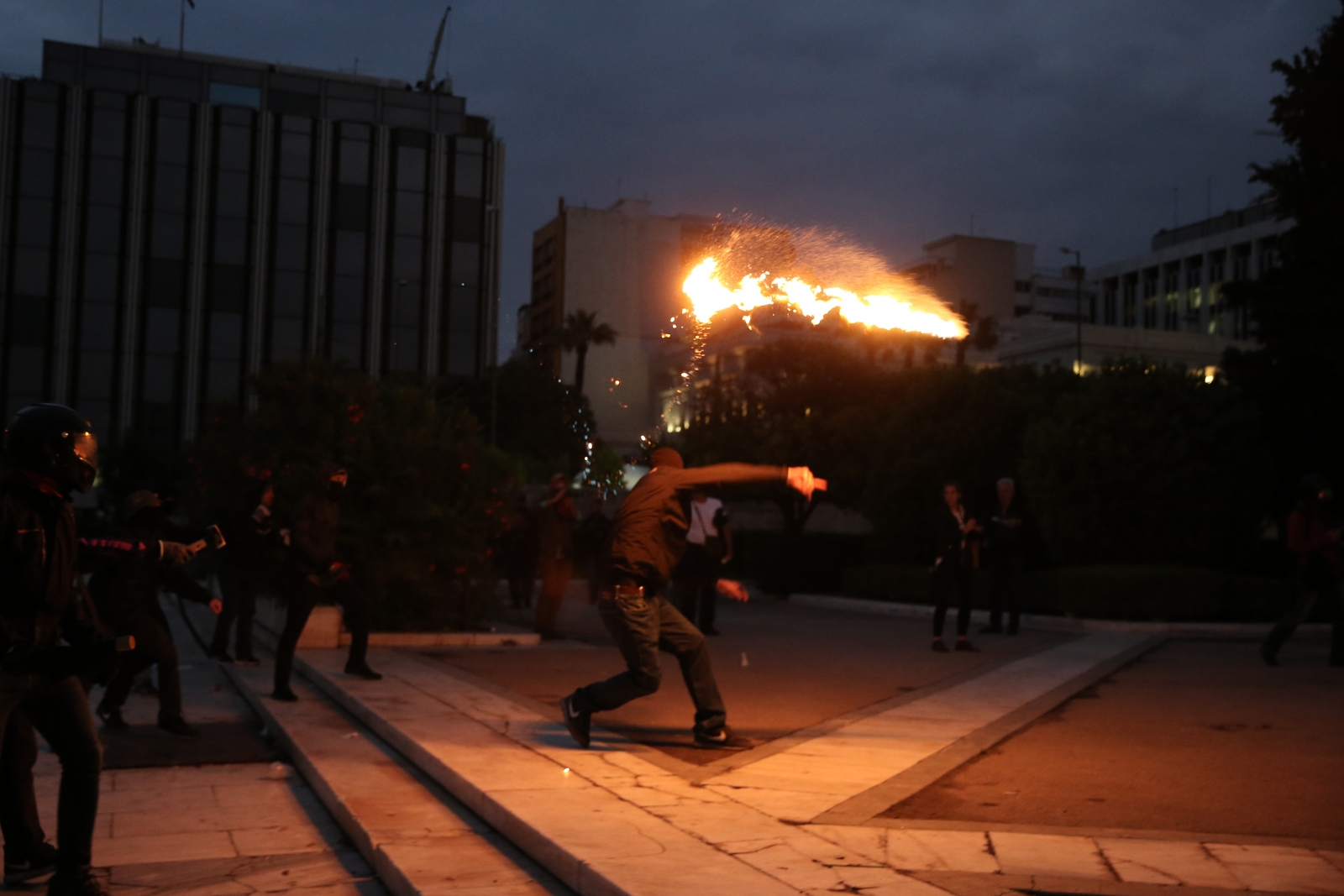 Greek police fire teargas at protesters outside parliament