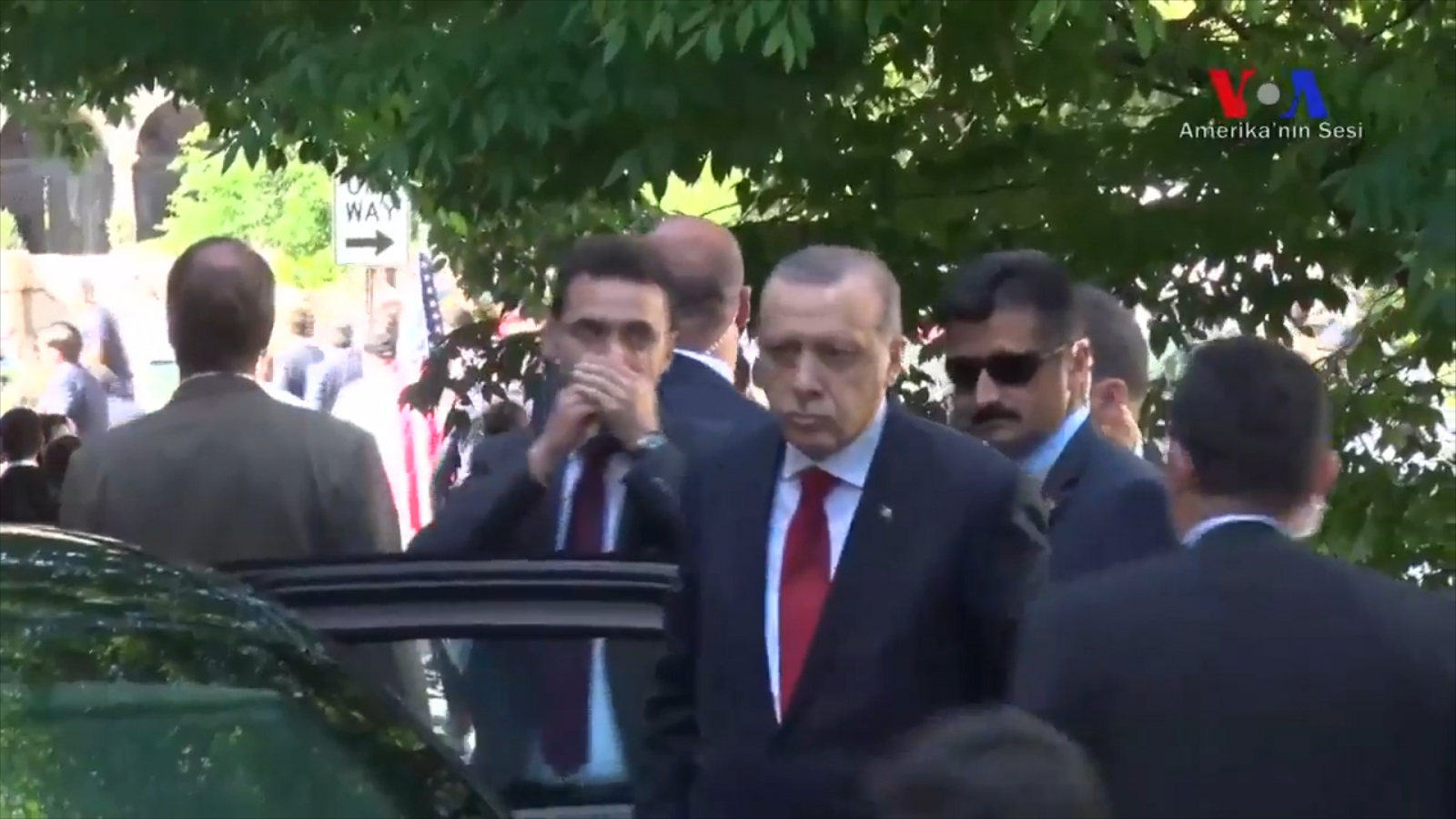 Turkish security clashes with protesters in Washington as Erdogan looks on