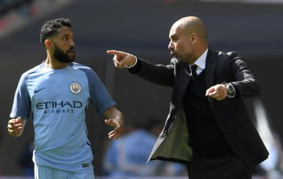 Gael Clichy and Pep Guardiola