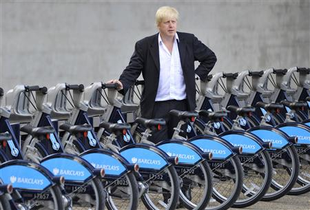 London Mayor Johnson poses with hire cycles beside the London Eye in central London