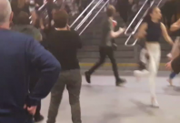 People run through Manchester's Victoria Station following explosions