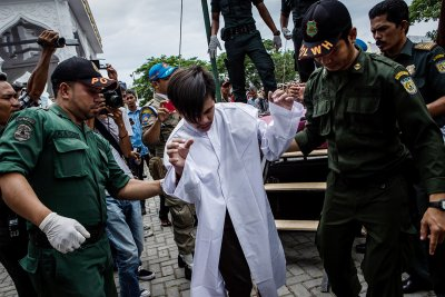 gay couple caned Aceh Indonesia shariah
