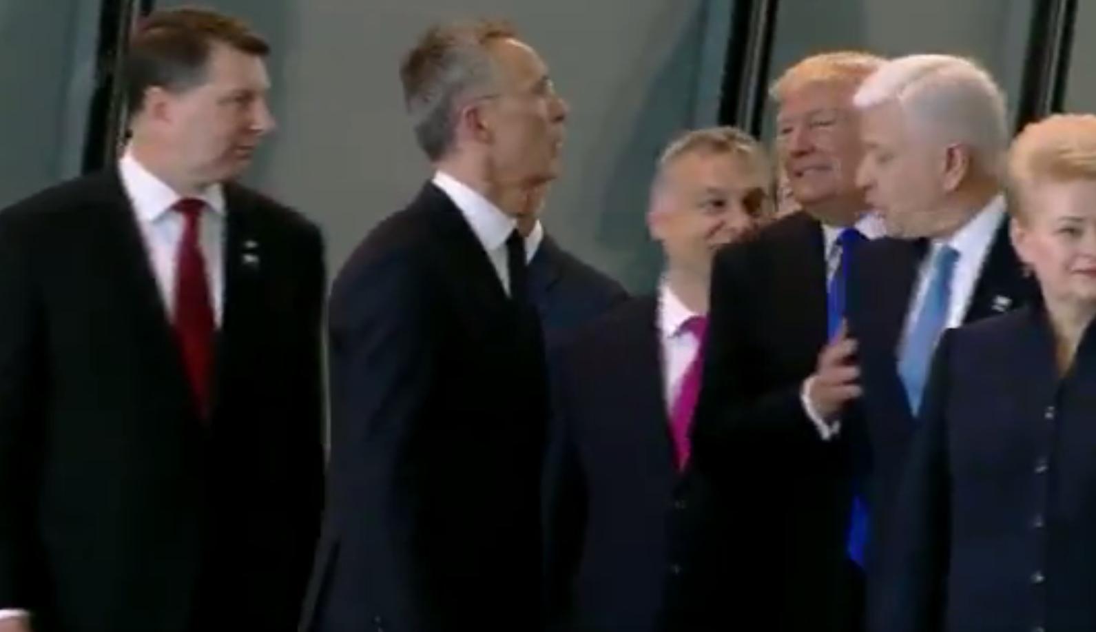 Trump shoves NATO leader