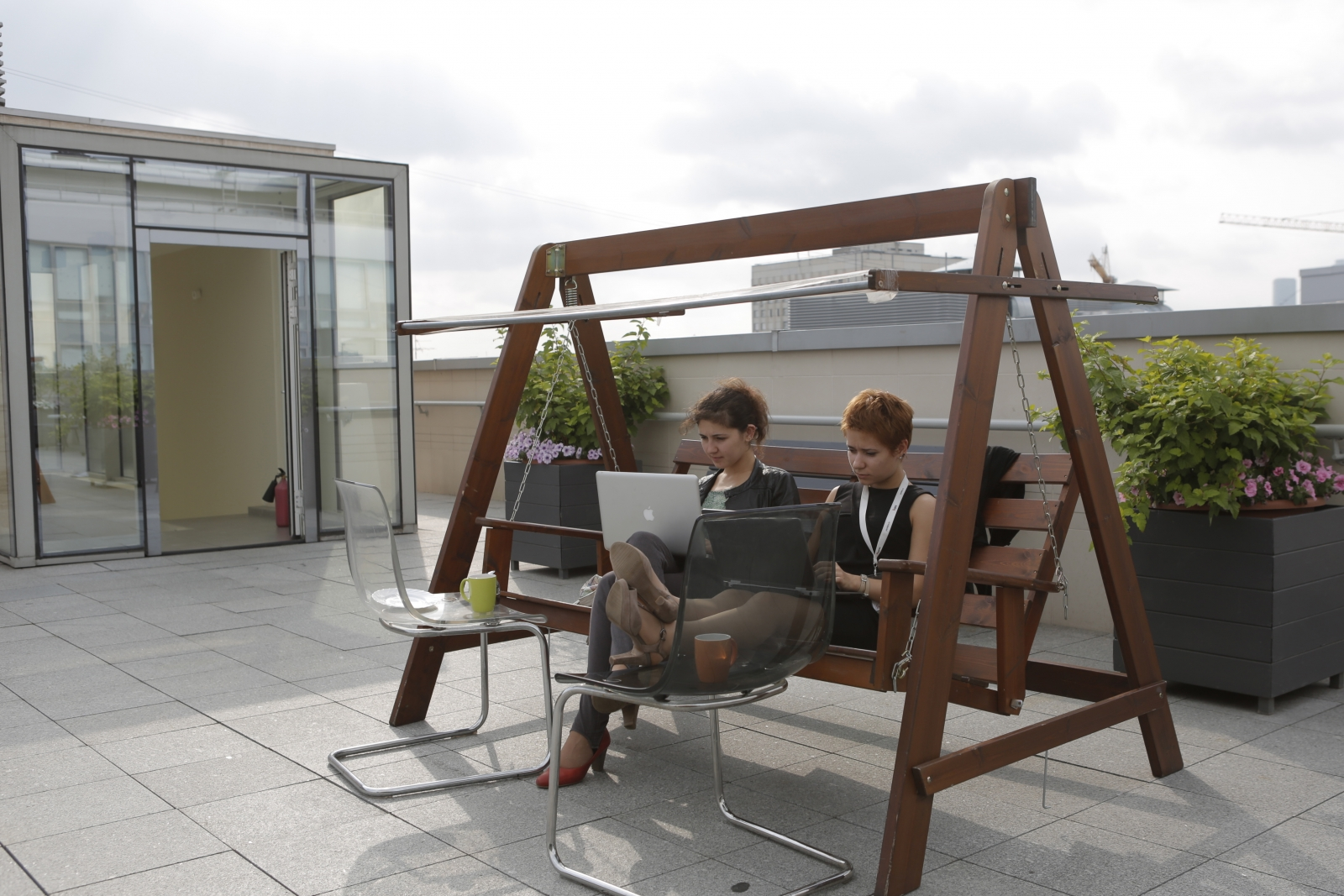 Yandex employees work on its roof top