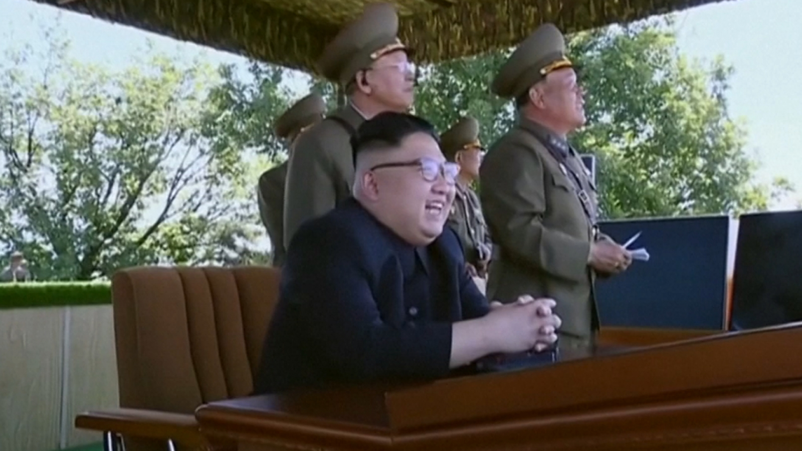 watch-a-childlike-kim-jong-un-chuckle-at-north-korean-military-display