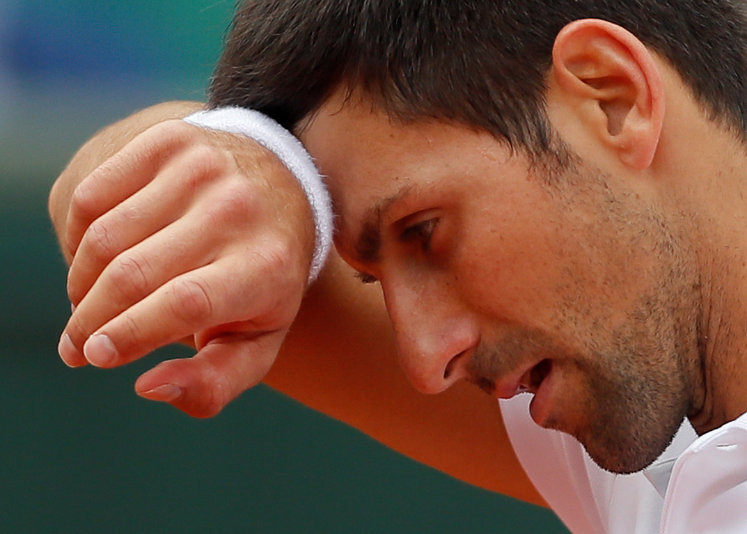 Novak Djokovic and Rafael Nadal quarter-final matches postponed because of rain
