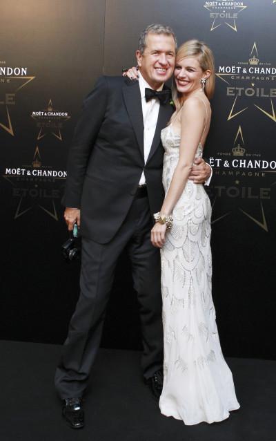 Testino and actress Miller