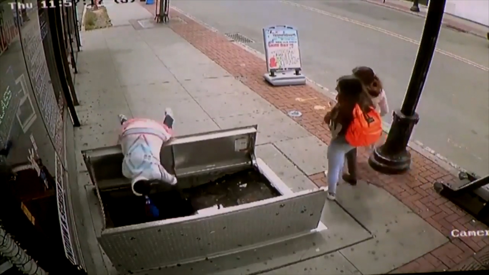 Cctv Footage Shows Woman In Fall Through Basement Doors In
