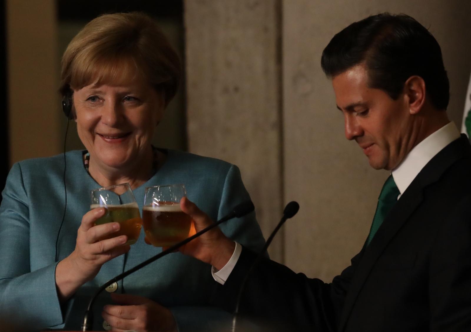 German Chancellor Angela Merkel  toasts
