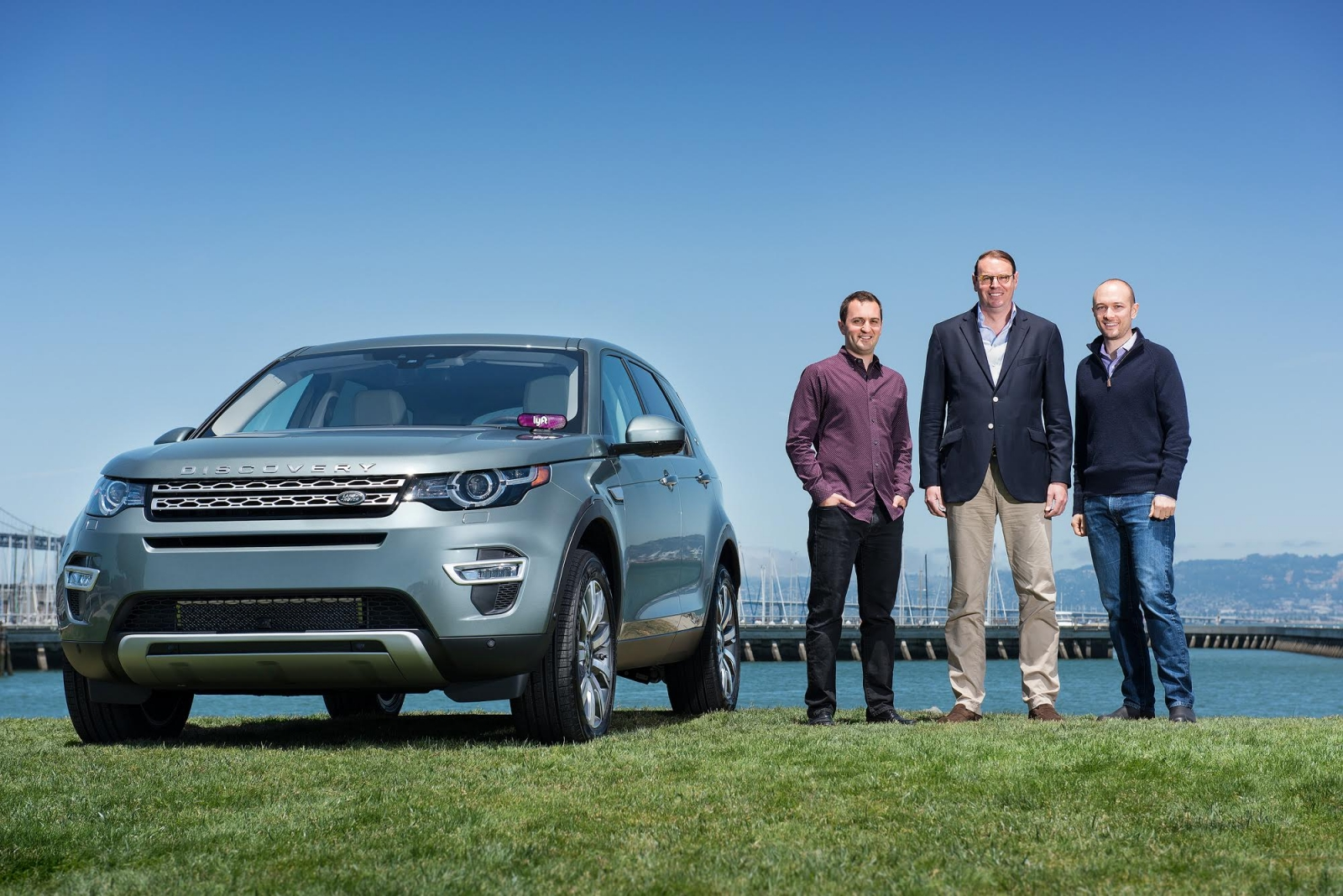 From left: Lyft president John Zimmer, Hanno Kirner of JLR and Logan Green, CEO of Lyft