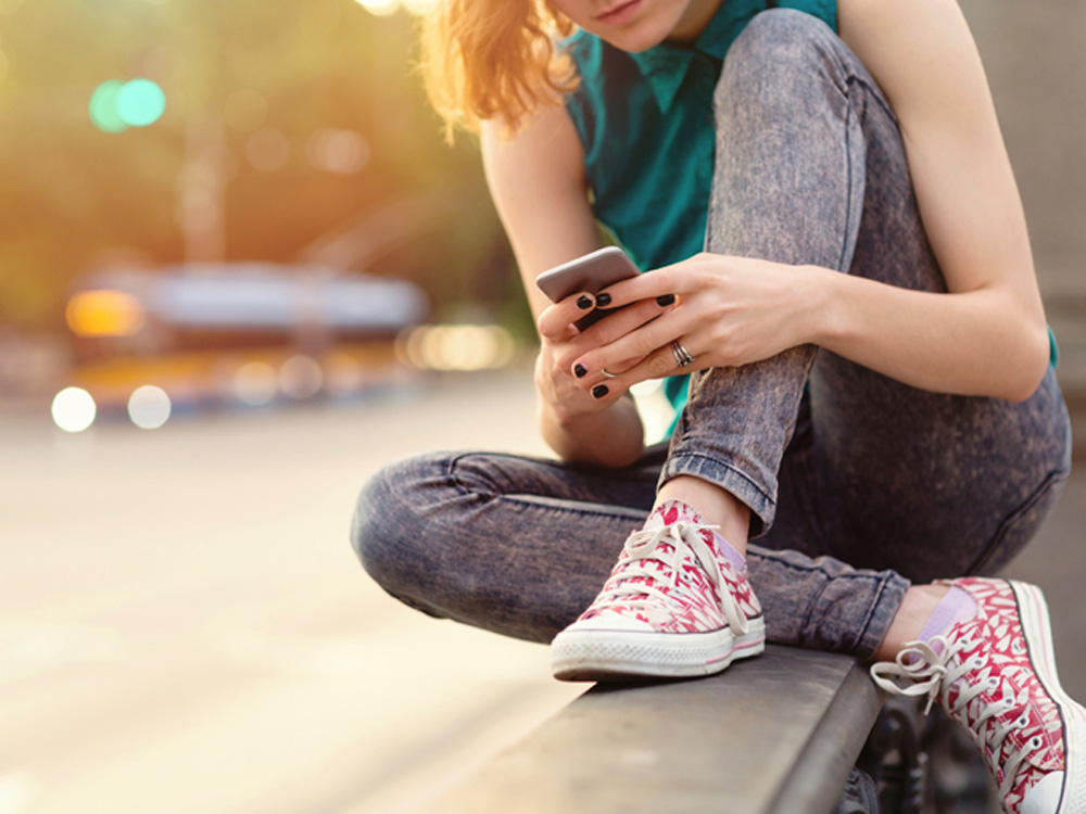 A teenager using a smartphone