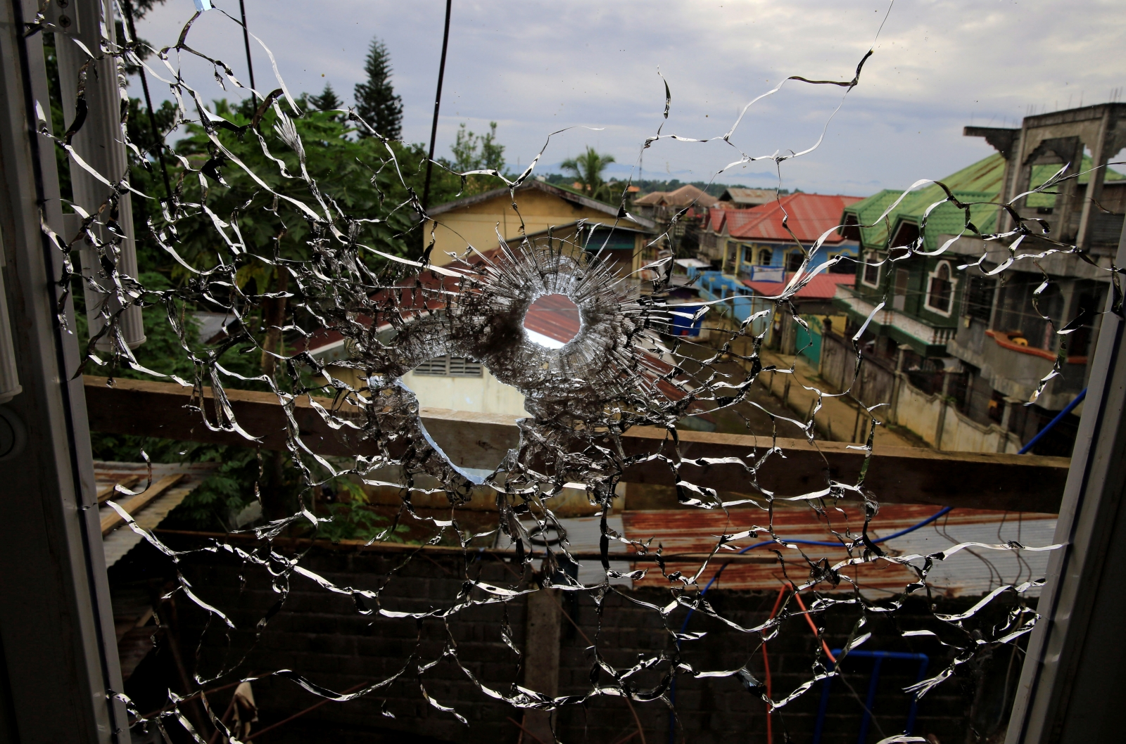 An abandoned hospital window is seen full of bullet holes in Marawi City