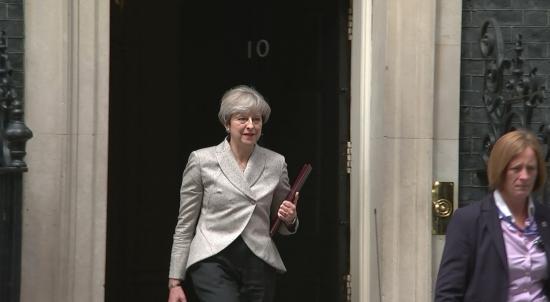 Theresa May Departs Downing Street for France Visit