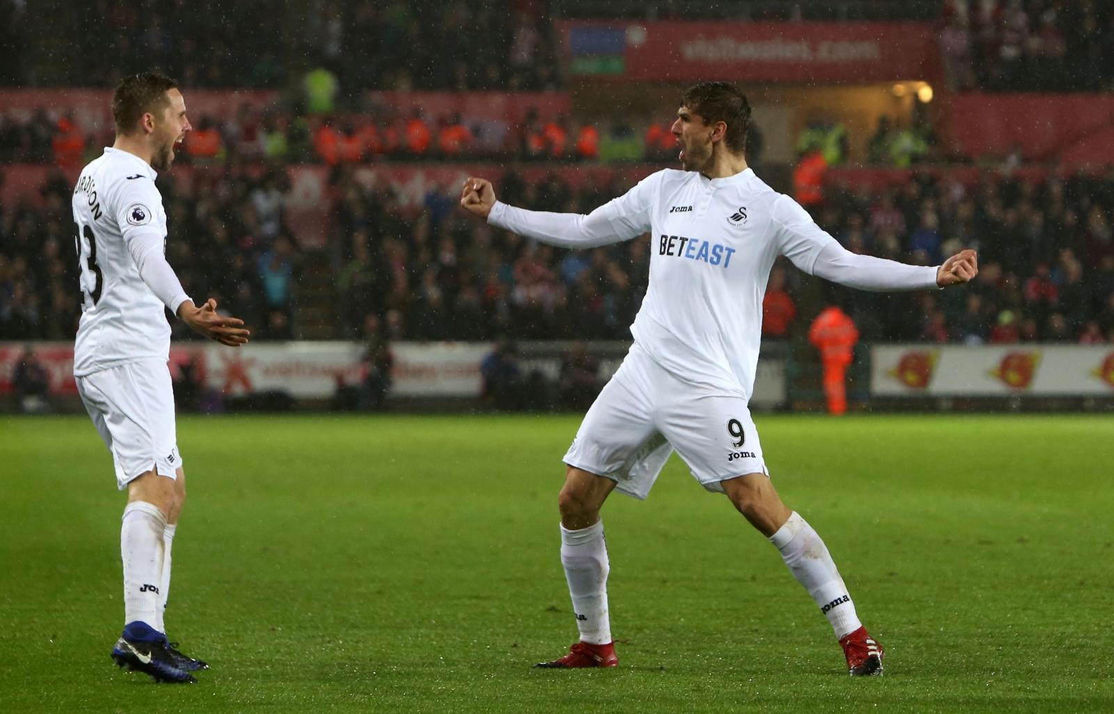 Gylfi Sigurdsson and Fernando Llorente