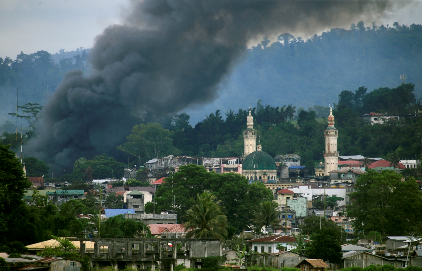 Smoke billows from a burning building as government troops continue their assault against insurgents from the Maute group, who have taken over large parts of Marawi city, Philippines June 16, 2017