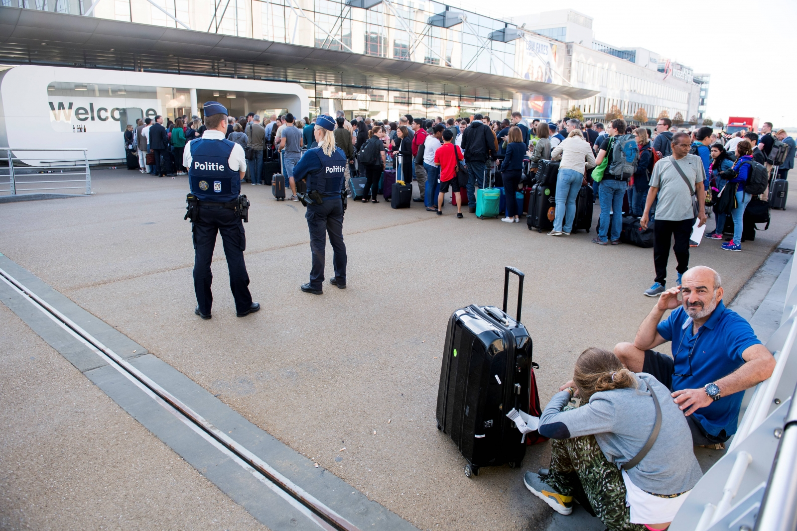 Police and passengers outside Brussels airport