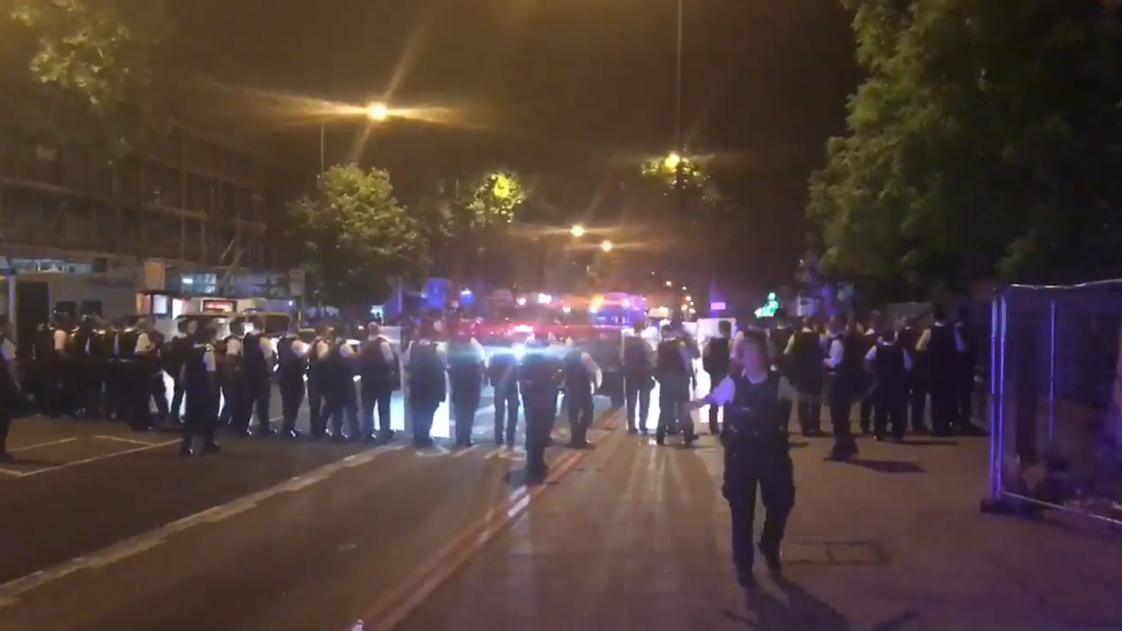 Riot police and youths armed with knives clash in London