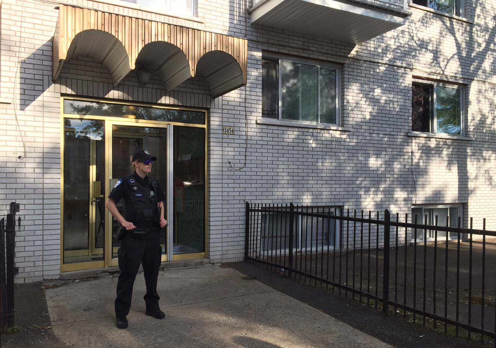 Police guard Amor Ftouhi's apartment building