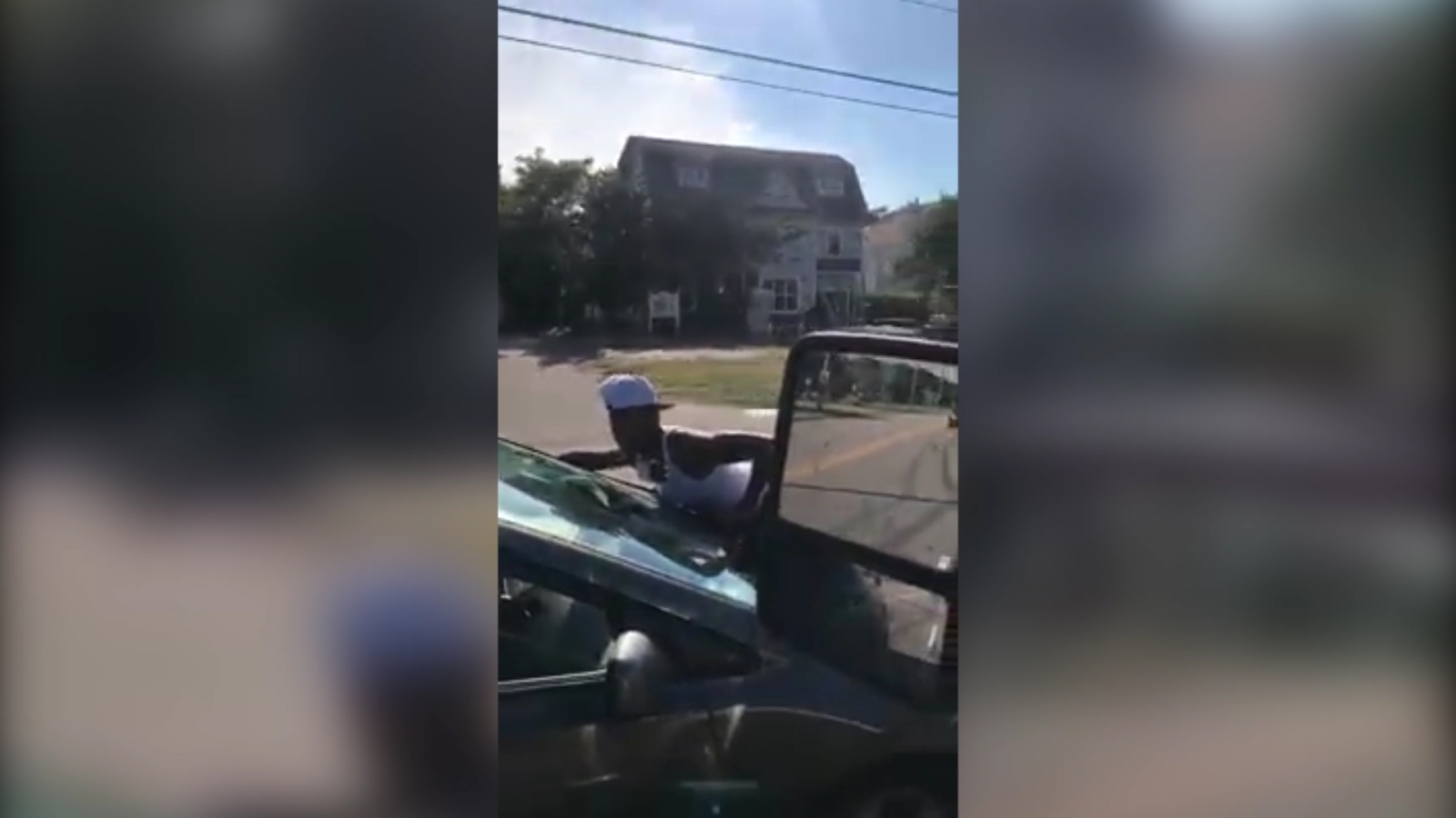 woman-clings-onto-car-in-bizarre-traffic-incident