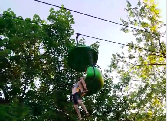 Girl dangles from ride