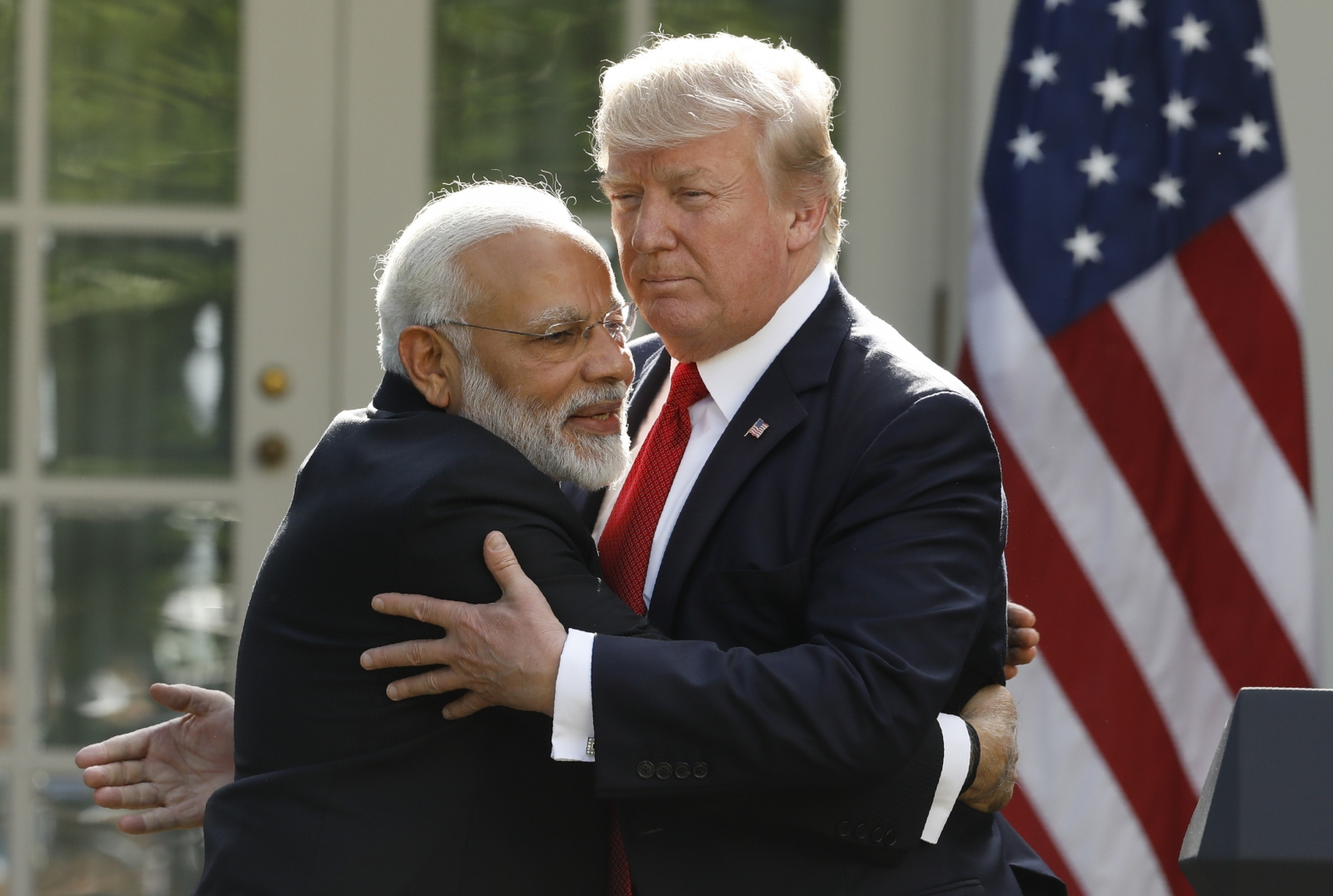 Trump and Modi hug