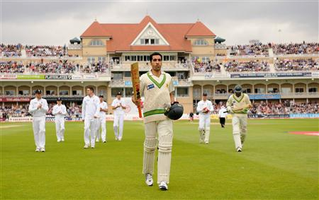 Pakistan's Umar Gul leaves the field during the first Test match against England at Trent Bridge cricket ground in Nottingham