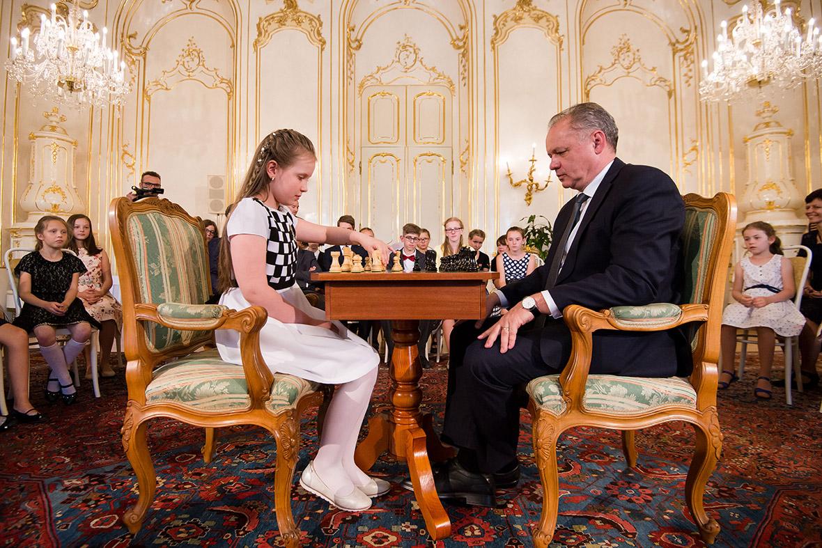 Andrej Kiska plays chess with Lucia Kapicakova