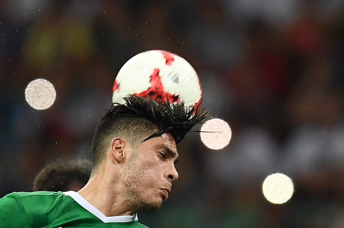 Mexicos Raul Jimenez heads the ball