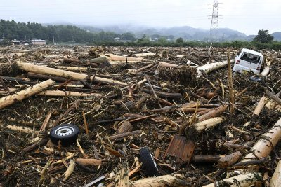 Japan floods landslides rain