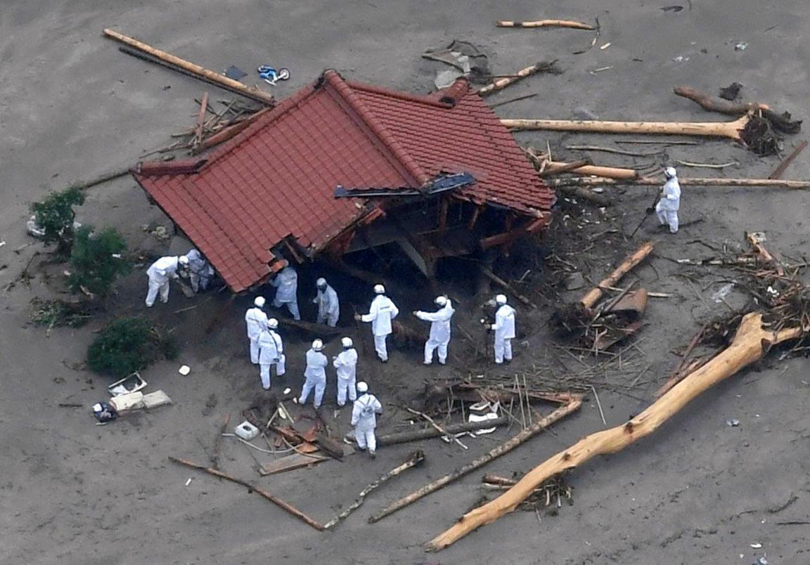 Japan floods landslides rain