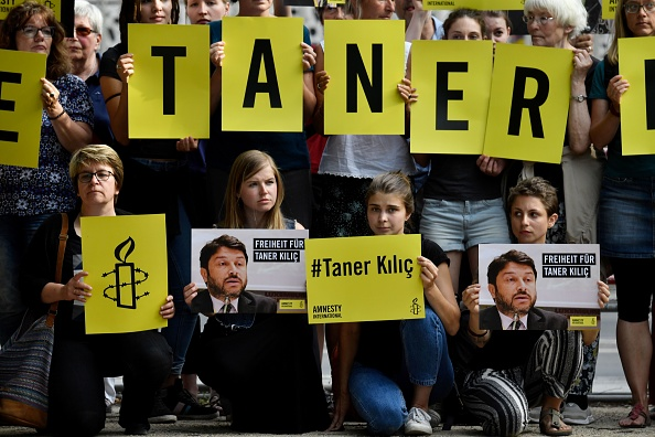 Turkey police detain Amnesty director and 12 other rights activists