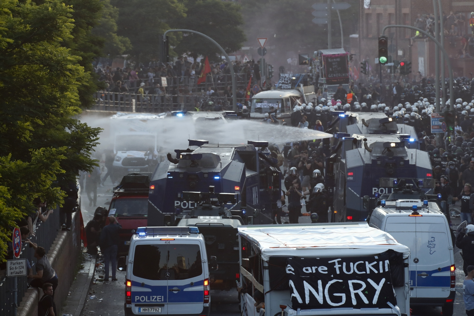 Riot police use water cannons in Hamburg