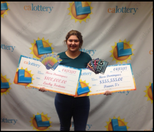 Rosa Dominguez and her two winning cheques