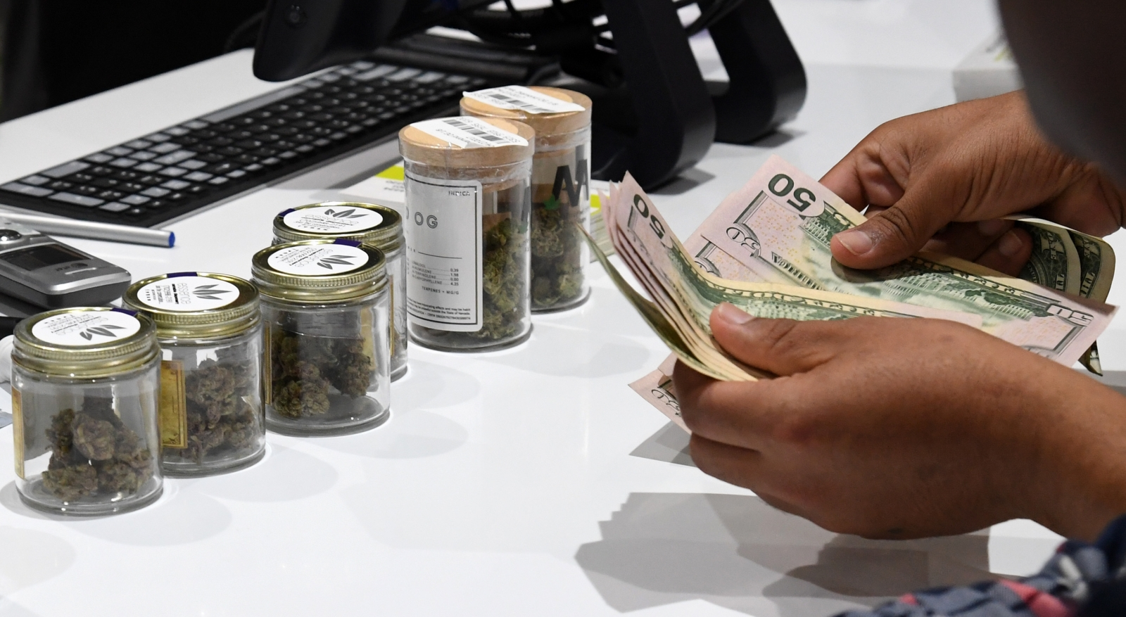 Customer pays for legal marijuana in Nevada