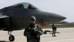 US Air Force guards F-22 fighter jet
