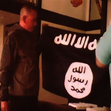 US army soldier kisses Isis flag