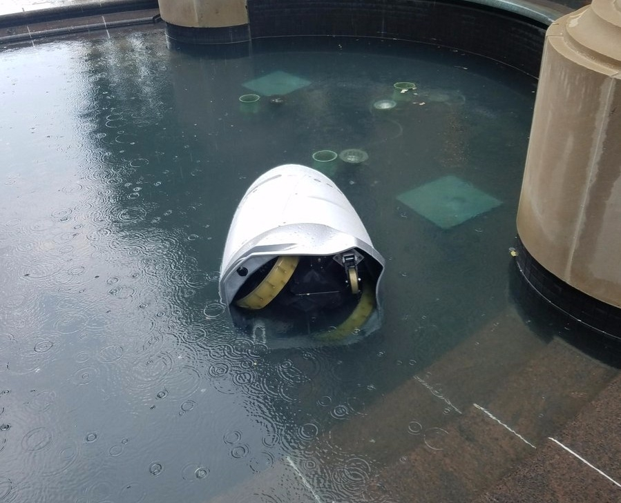 Robot cop found face down in office-block fountain