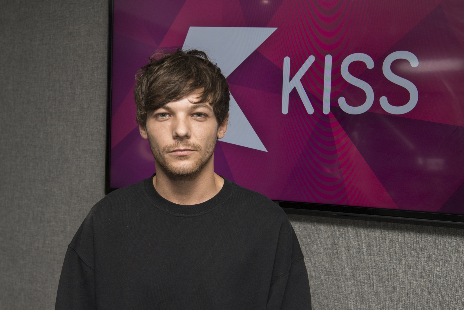Louis Tomlinson says 'keeping busy' has helped tackle heartache