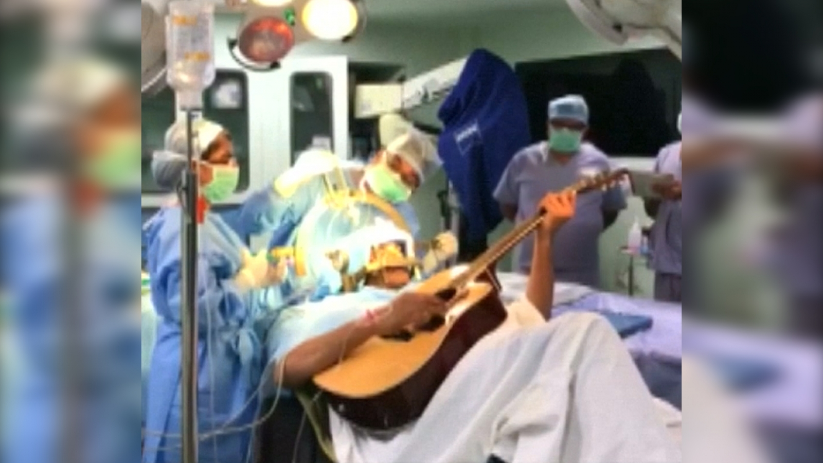 musician-plays-guitar-during-his-own-brain-surgery