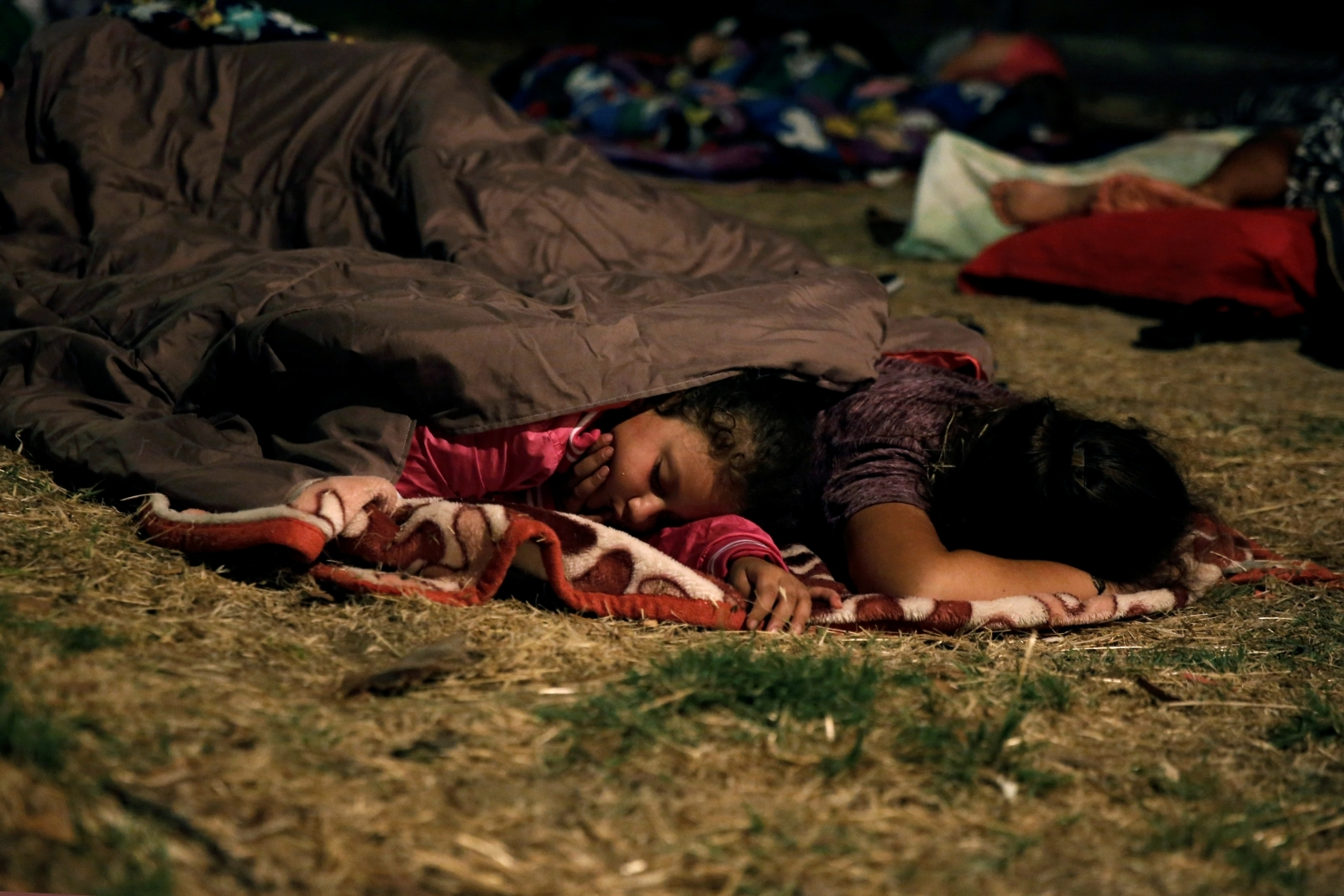 Children sleep outside after Koss earthquake