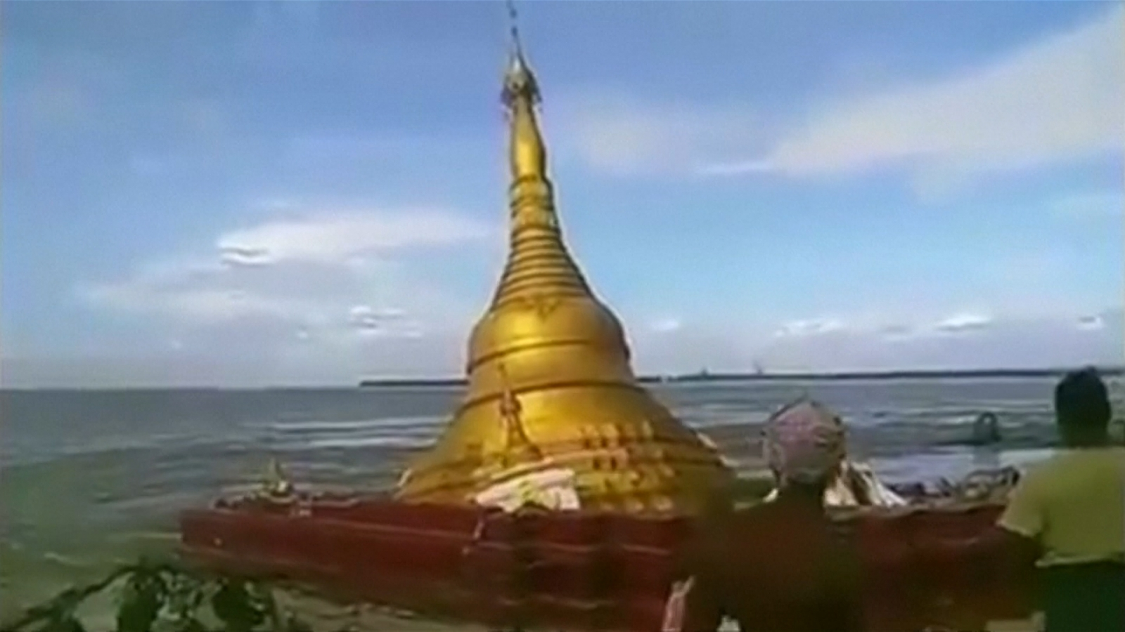 Rising river water levels causes Myanmar pagoda to collapse