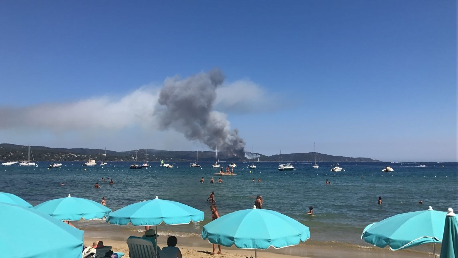 Flames seen from beach in France
